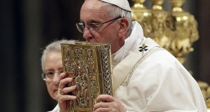 """Pope Francis on Saturday denounced how migrants, the poor and marginalized see their """"human dignity crucified"""" every day through injustice and corruption, and urged the faithful in an Easter Vigil message to keep hope alive for a better future. (AP/file)"""