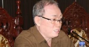 Drs John Palandung SH MSi
