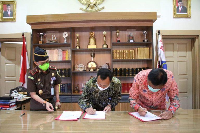 Penandatanganan Kesepakatan Bersama mengawal Dana Covid-19 di Sulut