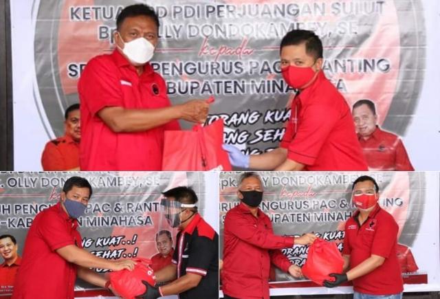 Ketua Olly Dondokambey SE saat membagi paket sembako kepada PAC dan Anak Ranting PDI Perjuangan Kabupaten Minahasa