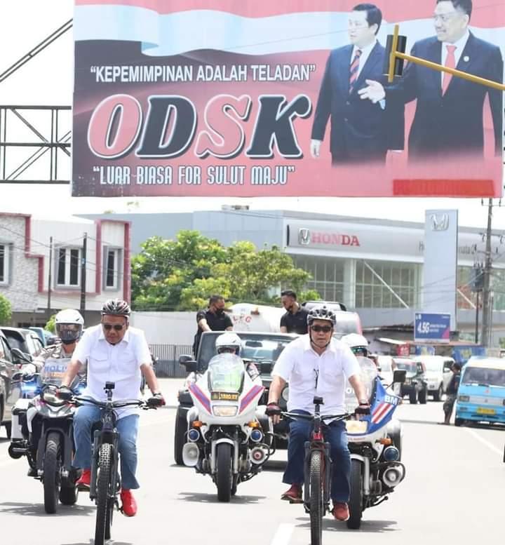 Olly Dondokambey SE dan Drs Steven OE Kandouw (ODSK) bersepeda mendaftar ke KPU Sulut