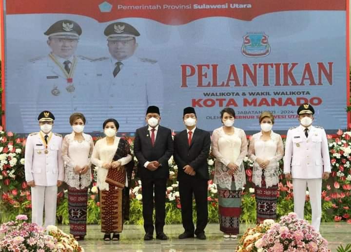 Foto bersama Gubernur dan Wakil Gubernur bersama pasangan dan Walikota dan Wakil Walikota Manado dan pasangan.