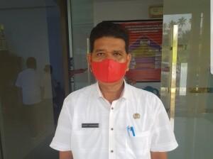 Alpret Pusunglaa Kepala Dinas Sosial dan Pemerintahan Masyarakat Desa