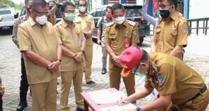 Penandatanganan surat kesepakatan RS Darurat Covid-19 oleh Gubernur dan Walikota Bitung, Selasa (27/07/2021).